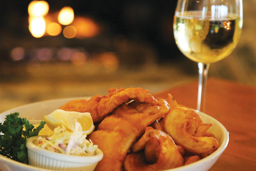 Chicken plate with a glass of white wine